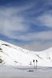 Skiing equipment on ski slope Stock Photo