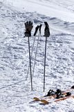 Skiing equipment on ski slope at sun day Stock Photography