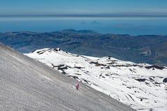Skiing on the Etna volcano with the background of Lipari Stromboli Aeolian Islands royalty free stock photos