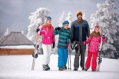 Skiing -family enjoying in winter vacation in mountains stock photos