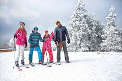 Skiing family enjoying winter vacation on snow in sunny cold day. In mountains and fun Stock Photography