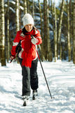 Skiing in the forest Royalty Free Stock Images