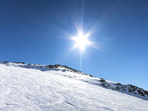 Skiing in French alps with a sun reflection Royalty Free Stock Photos