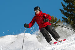 Skiing in fresh powder royalty free stock images