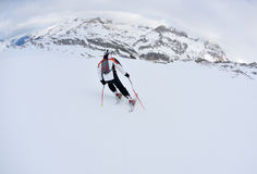 Skiing on fresh snow at winter season sunny day Royalty Free Stock Image