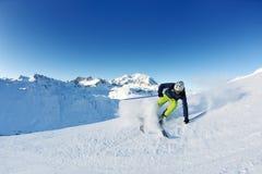Skiing on fresh snow at winter season sunny day Royalty Free Stock Photo