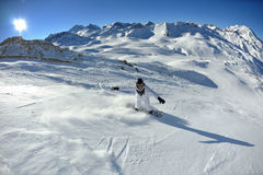 Skiing on fresh snow at winter season at sunny day Royalty Free Stock Images