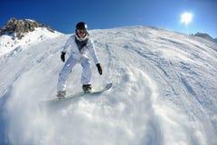 Skiing on fresh snow at winter season at sunny day Stock Image