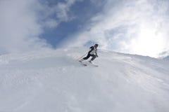 Skiing on fresh snow at winter season at sunny day Royalty Free Stock Photos