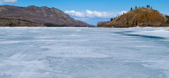 Skiing on Frozen Lake Laberge, Yukon, Canada Royalty Free Stock Image