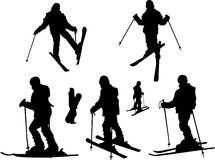 Skiing girl. Seven black silhouettes of skiing girl Stock Photos