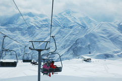 Skiing lift with people Royalty Free Stock Photography