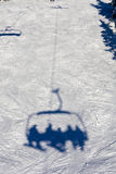 Skiing lift shadow Stock Photo