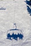 Skiing lift shadow Stock Photo