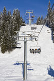 Skiing lift shadows and sun Royalty Free Stock Photo