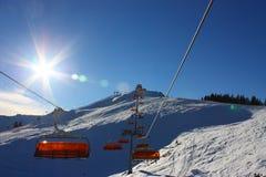 Skiing lift. Skiing slope and orange lift Stock Photography