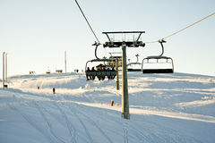 Skiing lift sun over the horizon. Ski lift/elevator at Kvitfjell, Norway Stock Photography