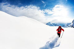 Skiing: male skier in powder snow Stock Photos