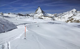 Skiing and the Matterhorn. Skiers and ski lifts in front of the majestic matterhorn in the southern swiss alps Royalty Free Stock Photo