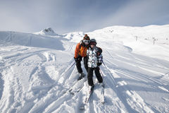 Skiing, mother and child. In the mountains, Areches, Savoie, France Royalty Free Stock Images