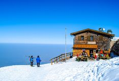 Skiing on mountain in Austria. Tourists have break from skiing on mountain in Austria, sunny day with blue sky Royalty Free Stock Image