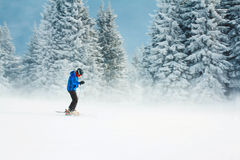 Skiing in a mountain forest Stock Photo