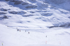 Skiing in the mountain. People skiing in snow-covered mountain in Switzerland Stock Image