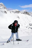 Skiing in mountains stock photo