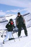 Skiing in mountains Royalty Free Stock Images