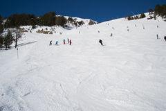 Skiing in mountains, Andorra. Active people are skiing on slope Alps, Andorra Royalty Free Stock Photography