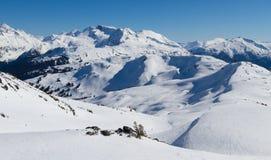 Skiing in the mountains Stock Photos