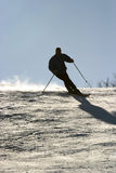 Skiing new. Silhouette of a man skiing Royalty Free Stock Photo