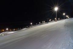 Skiing at night Stock Photo