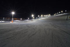 Skiing at night Stock Photos