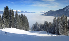 Skiing over the clouds panorama Stock Photo