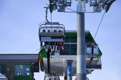 Skiing people in ski lift Stock Image