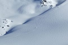 Skiing in the powder snow. 2 skiers skiing on a glacier in fresh powder snow Stock Photos
