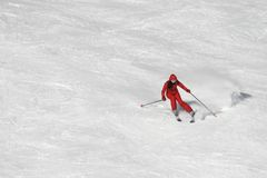 Skiing in red. Powder snow and offpiste skiing Royalty Free Stock Photo