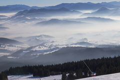 Skiing resort Kubinska Hola, Slovakia. Top view. Skiing park Kubinska Hola; Western Tatras. Slovakia. View from the ski slopes on snow covered and foggy valley royalty free stock photography