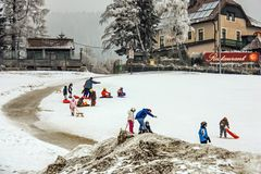 Children`s alpine ski school. Instructor and children students in colorful ski equipment royalty free stock image