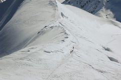 Skiing on the Ridge. 3 Skiers on a ridge on the Mt Blanc in the French Alps Stock Photography