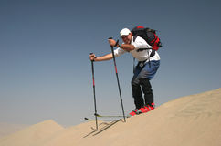 Skiing on sand dunes Stock Photos