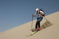 Skiing on sand dunes Royalty Free Stock Images