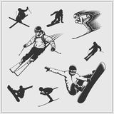 Skiing set. Silhouettes of skiers and snowboarders. vector illustration
