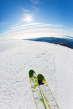 Skiing on a ski slope. Closeup perspective, fish-eye lens, vertical orientation Stock Photo