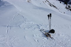 Skiing. Ski and skiing sticks on the top of a mountain Royalty Free Stock Photo