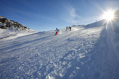 Skiing. Skier skiing downhill in snowy Austria Stock Photo