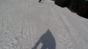 Skiing skiers on the piste in Bukovel ski resort, Ukraine stock video footage