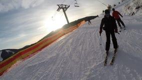 Skiing skiers on the piste in Bukovel ski resort, Ukraine stock footage