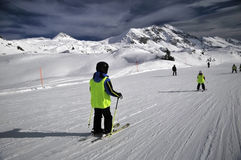 Skiing slope. Winter sports: skiers on ski slope royalty free stock photo